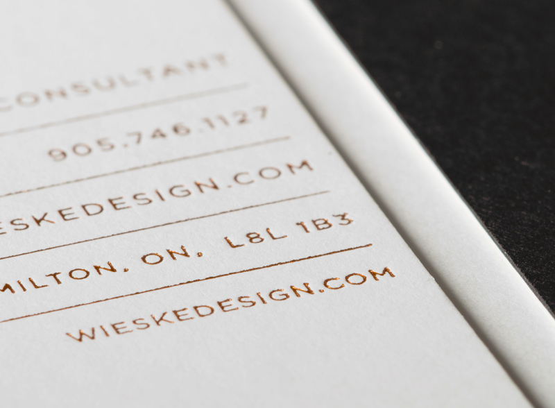Duplex business card with a copper foil detail designed by Richard Baird for interior design studio Wieske Design